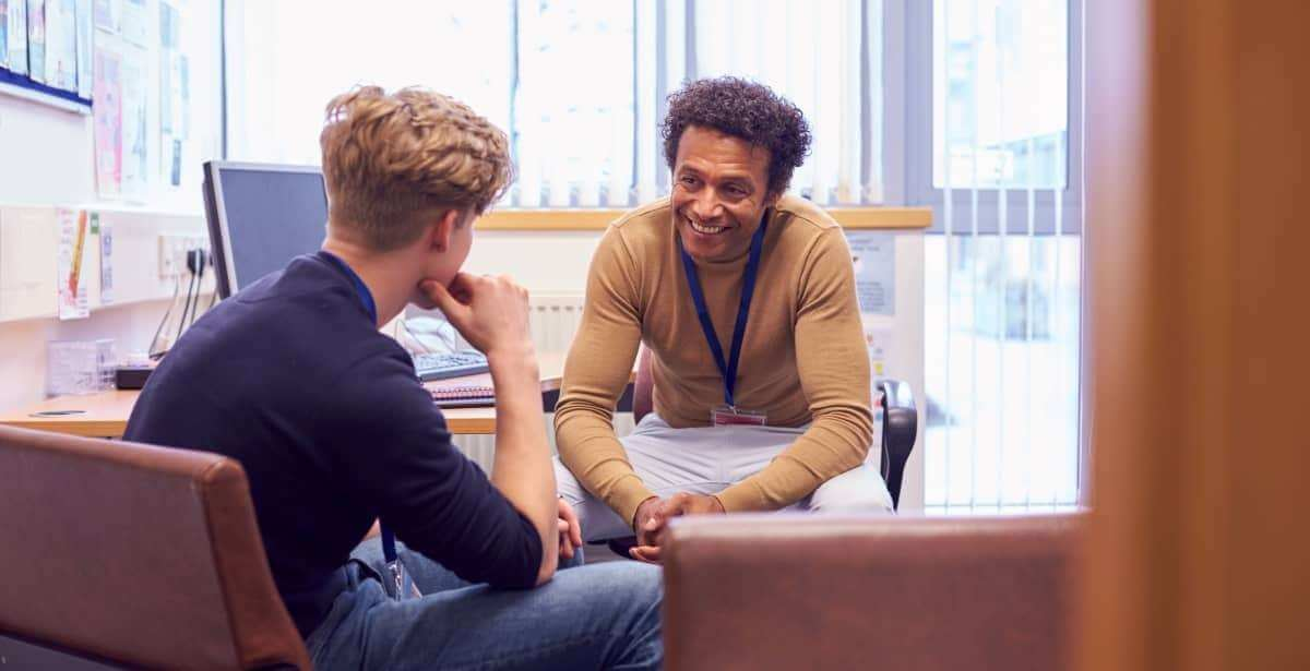 Clinical mental health counselor with young male client