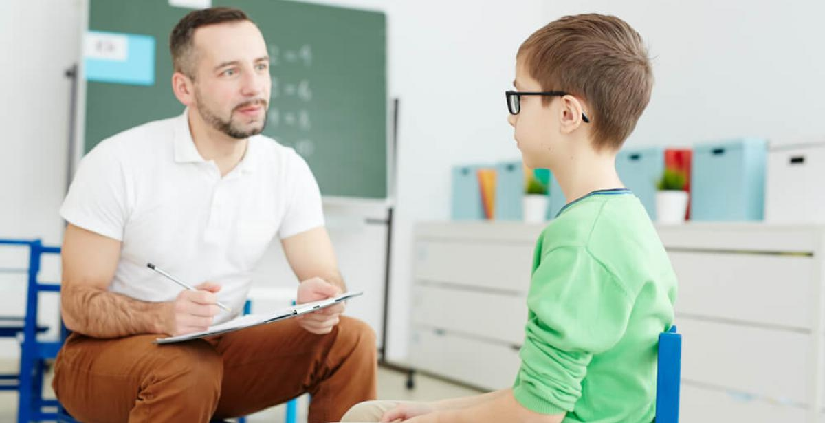 teacher counseling young boy